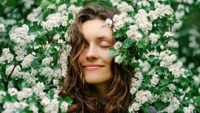Young happy smiling green-eyed woman with flowers. natural beauty Royalty Free Stock Photos