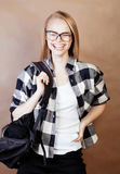 Young happy smiling hipster blond girl with backpack ready to school, teenage lifestyle people concept Stock Images