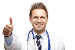 Young happy smiling male doctor show thumb Royalty Free Stock Image