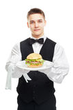 Young happy smiling waiter holding hamburger on plate Royalty Free Stock Photography