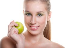 Young happy smiling woman with apple Royalty Free Stock Images
