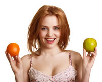 Young happy smiling woman with apple and orange Royalty Free Stock Image