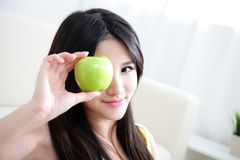 Young happy smiling woman with apple Stock Photography