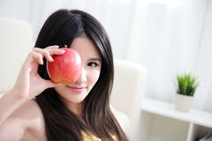 Young happy smiling woman with apple Royalty Free Stock Photography