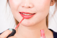 Young happy smiling woman with cosmetics brush Royalty Free Stock Photos
