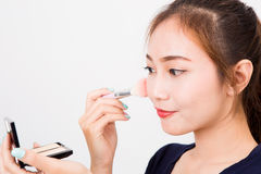 Young happy smiling woman with cosmetics brush Royalty Free Stock Photography