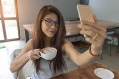 Young happy smiling woman drinking morning coffee. Stock Photo