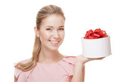 Young happy smiling woman with a gift in hand. Isolated. Stock Photography