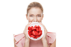 Young happy smiling woman with a gift in hands. Isolated. Royalty Free Stock Photo