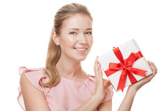 Young happy smiling woman with a gift in hands. Isolated. Royalty Free Stock Photos