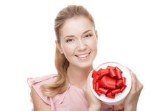 Young happy smiling woman with a gift in hands. Isolated. Royalty Free Stock Photography