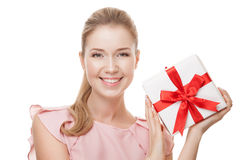 Young happy smiling woman with a gift in hands. Isolated. Royalty Free Stock Images