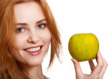 Young happy smiling woman with green apple Stock Images