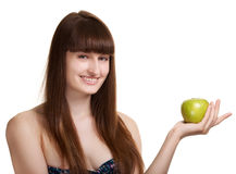 Young happy smiling woman with green apple Stock Photo