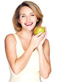 Young happy smiling woman with green apple. Stock Photography