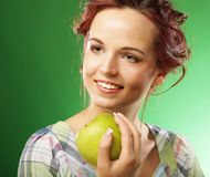 Young happy smiling woman with green apple Royalty Free Stock Photography