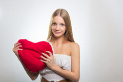 Young happy smiling woman with heart symbol Stock Photos