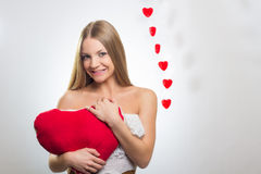 Young happy smiling woman with heart symbol Royalty Free Stock Photography