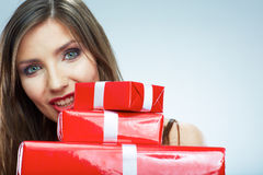 Young happy smiling woman hold red gift box. Stock Image