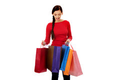 Young happy smiling woman holding shopping bags Stock Image