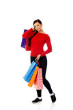 Young happy smiling woman holding shopping bags Stock Photo