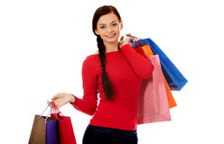 Young happy smiling woman holding shopping bags Stock Photos