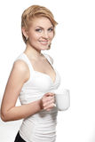Young happy smiling woman holding white cup of cof Stock Photography