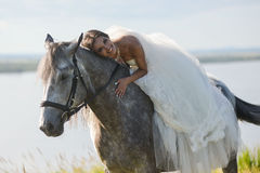Young happy smiling woman with horse Stock Photo
