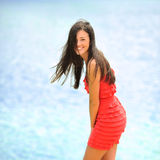 Young happy smiling woman laughing over sea background Royalty Free Stock Photo