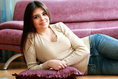 Young happy smiling woman lying on the floor Stock Image