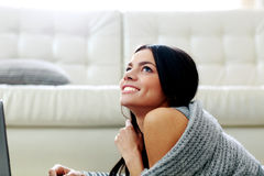 Young happy smiling woman lying Royalty Free Stock Photos