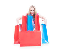 Young happy smiling woman posing with shopping bags Stock Image