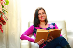 Young happy smiling woman reading a book stock photo