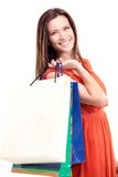 Young happy smiling woman with shopping bags Royalty Free Stock Images