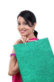 Young happy smiling woman with shopping bags Royalty Free Stock Photography