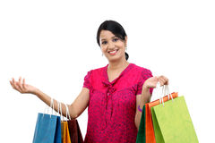 Young happy smiling woman with shopping bags. Against white Stock Photos