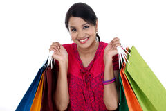 Young happy smiling woman with shopping bags Stock Photography