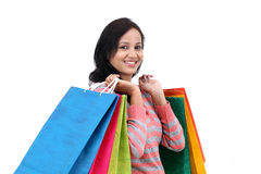 Young happy smiling woman with shopping bags Royalty Free Stock Image