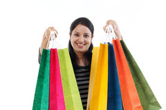 Young happy smiling woman with shopping bags Royalty Free Stock Photos