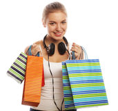 Young happy smiling woman with shopping bags Stock Images