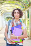 Young happy smiling woman (student, teacher) holding books Stock Image
