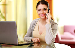Young happy smiling woman talking on the phone Stock Image