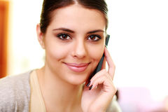 Young happy smiling woman talking on the phone Stock Photography