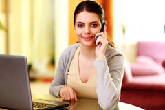 Young happy smiling woman talking on the phone Stock Photos