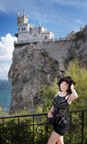 Young happy smiling woman. Tourist walking in Crimea. Swallow`s Nest background Stock Images