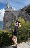 Young happy smiling woman. Tourist walking in Crimea. Swallow`s Nest background Royalty Free Stock Photo