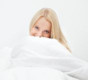 Young happy smiling woman waking up Stock Photos