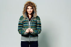 Young happy smiling woman in warm winter outfit Royalty Free Stock Photo