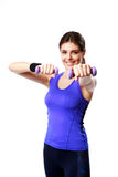 Young happy sport woman with dumbbells working out Royalty Free Stock Photo