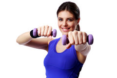Young happy sport woman with dumbbells working out Stock Photo